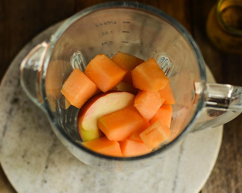 chopped fruit in a blender