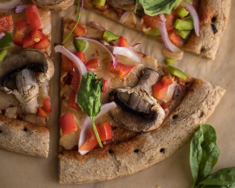 Slice of homemade veggie pizza