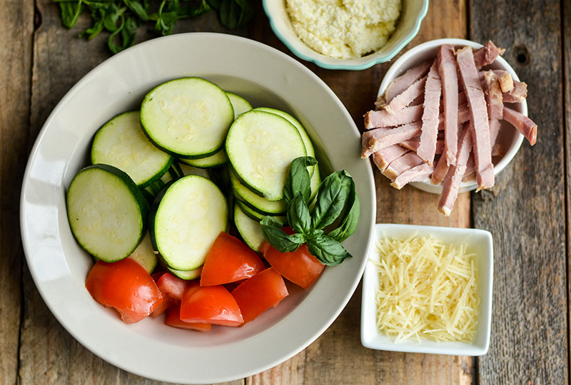 Chopped raw zucchini, tomato, Canadian bacon and Parmesan cheese