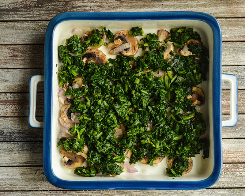 Spinach thawed in pan for quiche