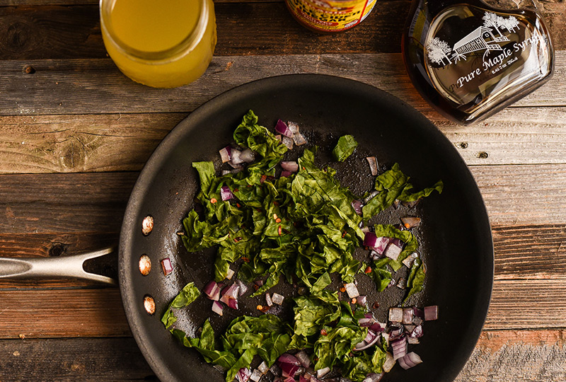 Cooked collard greens in a skillet