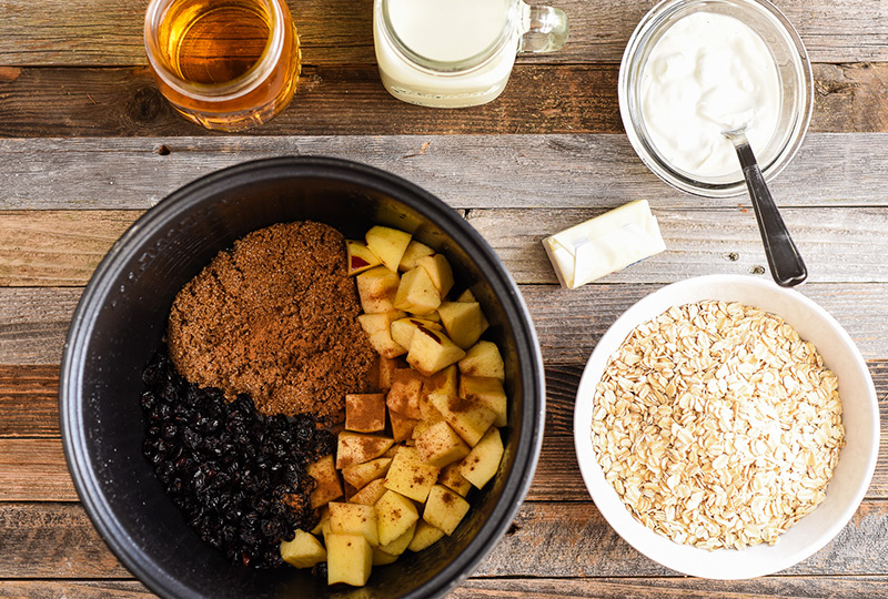 Ingredients placed in slow cooker to make cranberry oatmeal