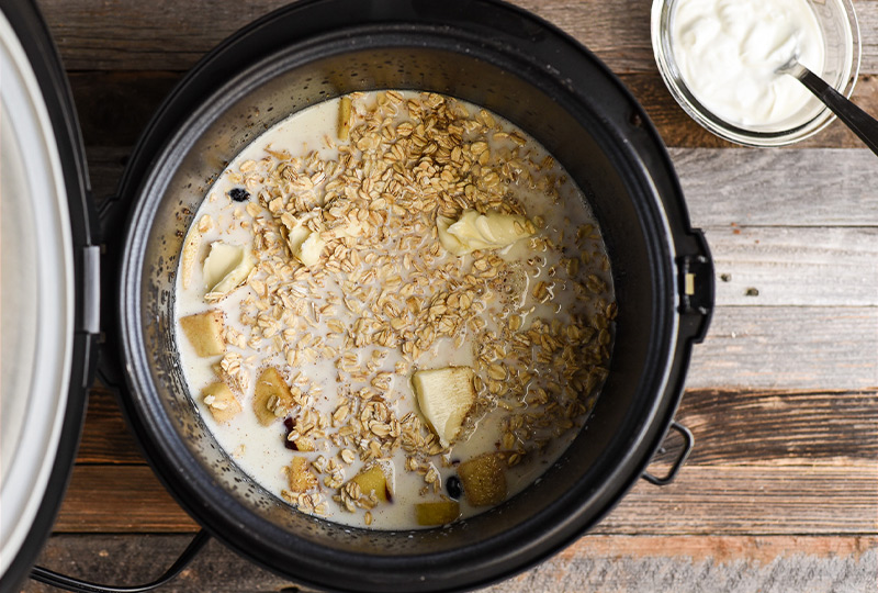 Milk poured over oatmeal in slow cooker