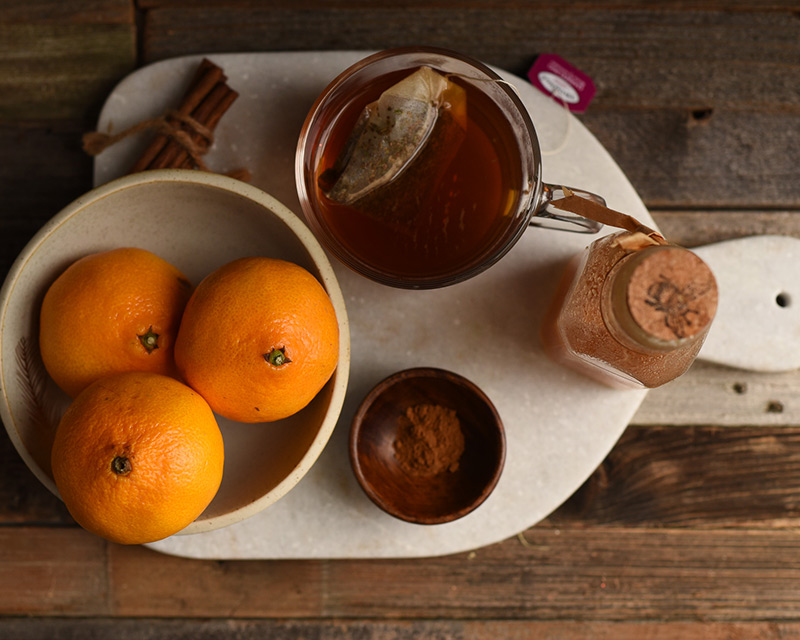 Mandarin oranges, honey and cardamon measured out for making tea-infused mandarin oranges.