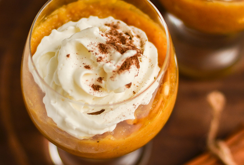 Closeup of pumpkin parfait in round glass.