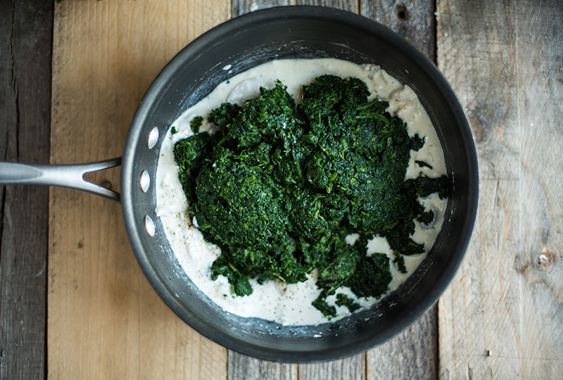 Spinach in pot with melted cream cheese