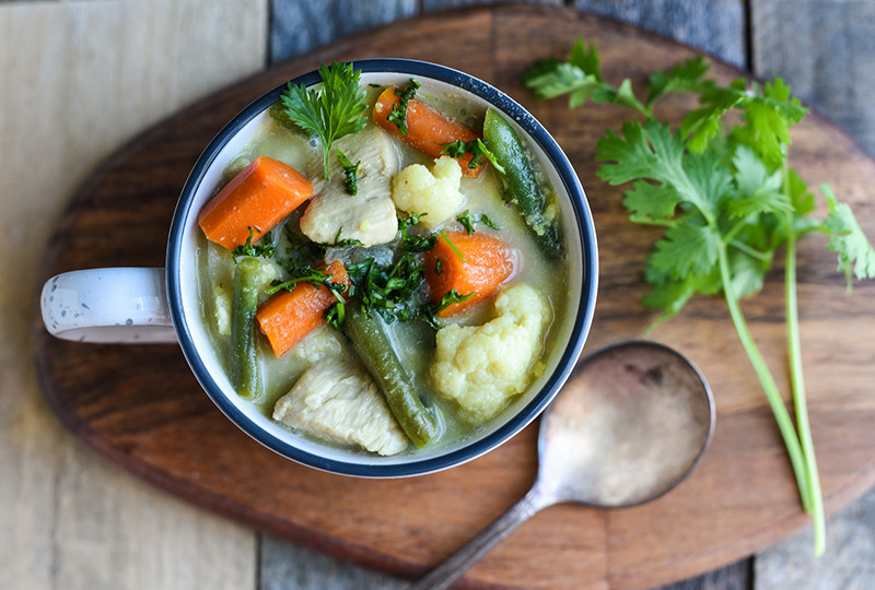 Thai chicken and vegetable soup in a bowl.