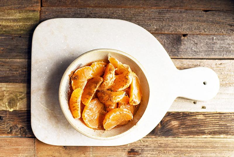 Clementine segments sprinkled with ground cardamom