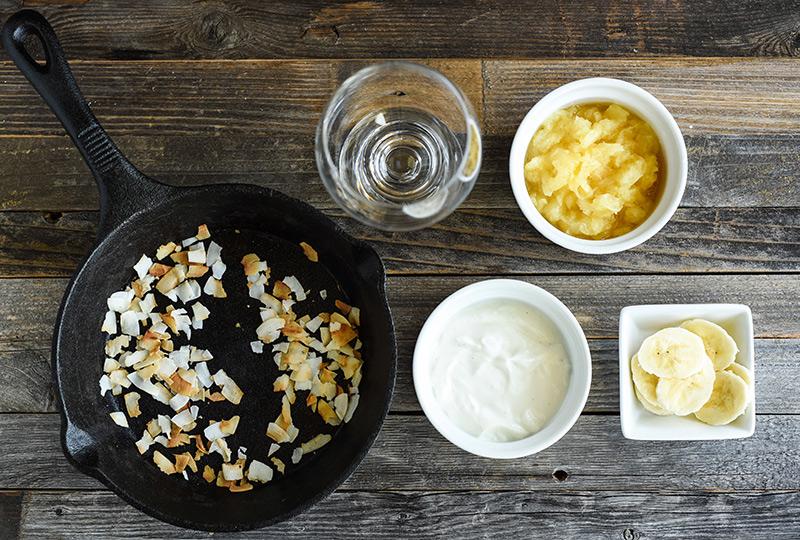 Ingredients for yogurt parfait displayed in bowls