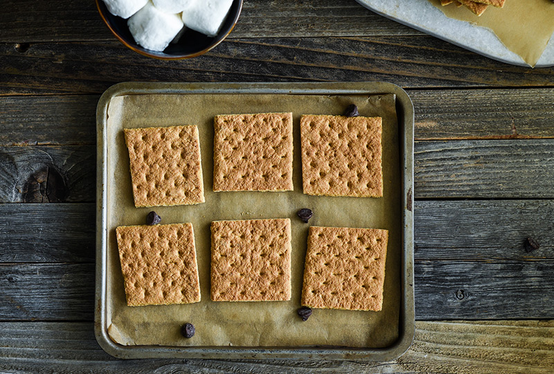 Graham crackers laid out on a baking pan