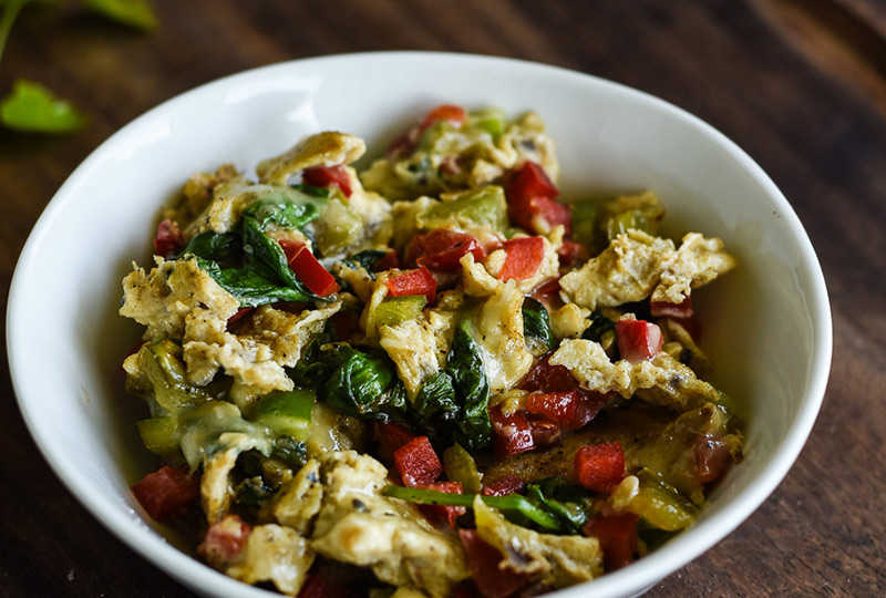 Eggs scrambled with chopped vegetables, in a serving bowl