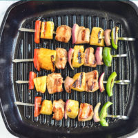 Grilled pineapple chicken kebobs on grill pan