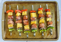Pineapple chicken kebabs on skewers ready to grill