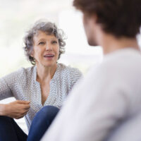Older woman talking with someone.