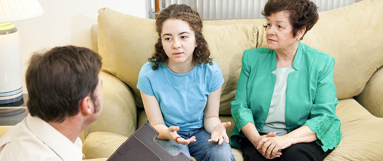 Pre teen talking to doctor about HPV vaccine
