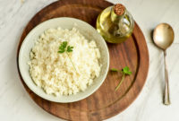 Cauliflower finely chopped in a bowl.