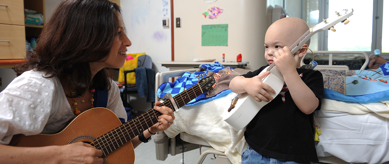 Music therapy helps the children cope with all aspects of their hospitalization. Music is something that most children and families have experience with and thus is familiar and welcome in the healing process. A symphony rainbow, a chorus so bright Music is healing us all through the night