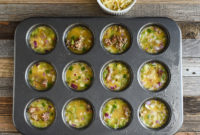 Raw egg mixture in muffin pans