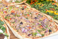 Pizza made with tuna and vegetables as topping