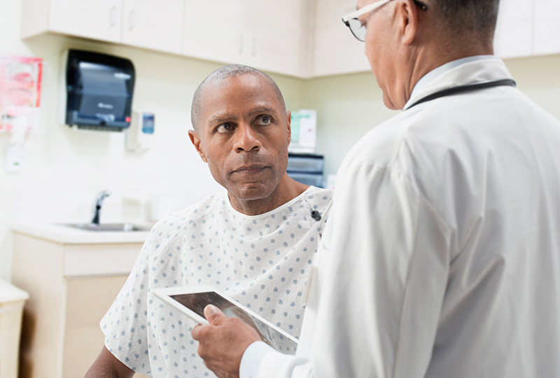 doctor talking with man about screening