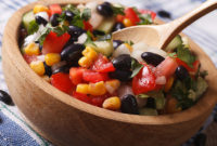 Bowl of tomato salsa with corn and black beans