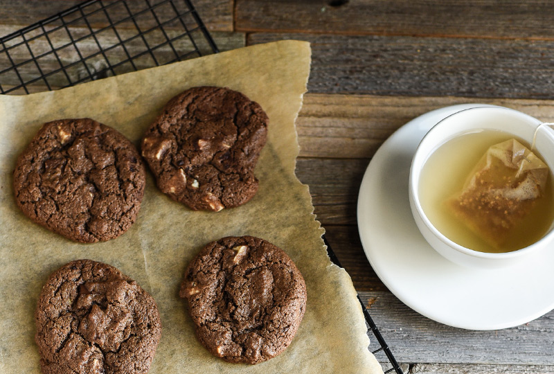 Triple chocolate cookies cooling from the oven.