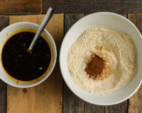 Bowl of wet ingredients and bowl of flour and cinnamon ready for mixing.