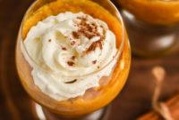 Closeup of pumpkin parfait in round glass.