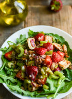 Chicken and strawberry salad in a serving bowl.