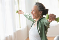 Older woman exercising with dumbbells