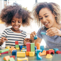 Mom and daughter play with blocks