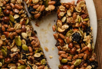 Closeup of homemade energy bars with pumpkin seeds, almonds and dried fruit.
