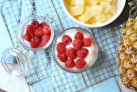 Raspberries top a cup of yogurt