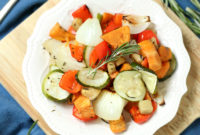 Mixed roasted vegetables on a white plate.