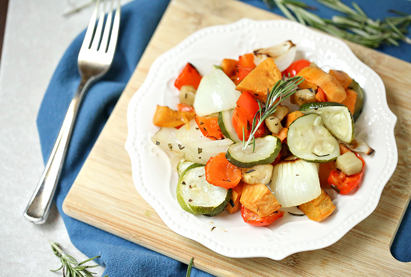 Mixed roasted vegetables on a white plate