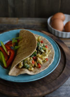 Eggs scrambled with vegetables, folded into a tortilla