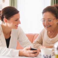 Woman receiving care and support at home.