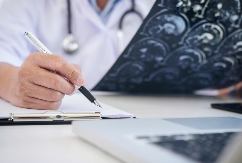 Epilepsy physician analyzing patient's seizure history and diagnosis