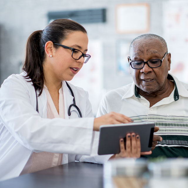 Doctor speaking to patient about weight loss procedure