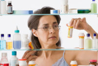 Woman figuring out how to dispose of medication.