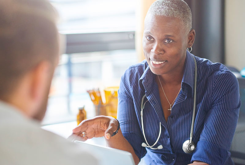 Doctor speaking to patient on reducing afib stroke risks.