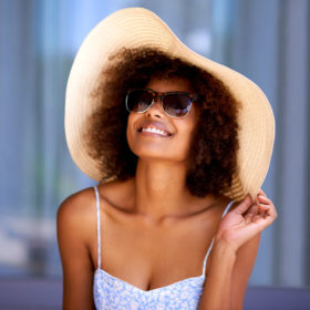 Woman enjoying time outdoors and taking steps to prevent skin cancer.