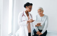 Patient speaking to her doctor during her Medicare annual wellness visit.