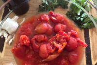 Bowl of hand-crushed cooked tomatoes and their juice